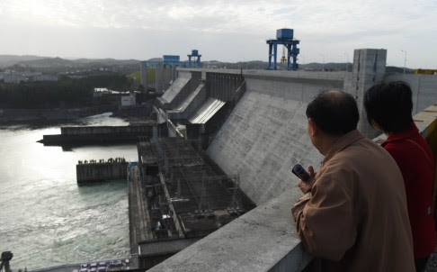 Visitors on top of the Danjiangkou dam at Danjiankou in China's central Hubei province. Photo: AFP