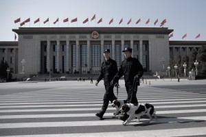 Two policeman leads police dogs guarding in front of the Great Hall of the People <a href=