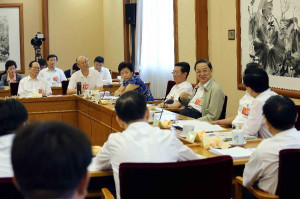 Yu Zhengsheng, chairman of the National Committee of the Chinese People's Political Consultative Conference (CPPCC), attends the group discussion of the meeting of local political consultative organizations to exchange work experiences, in Beijing, capital of China, July 16, 2015. (Xinhua/Liu Weibing)