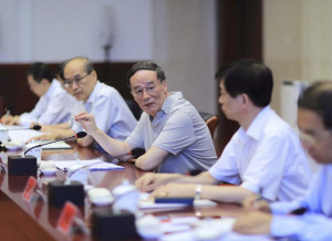 Wang Qishan (C), a member of the Standing Committee of the Political Bureau of the Communist Party <a href=