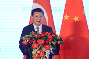 Xi Jinping speaks during a China-Turkey economic summit held in Beijing on July 30. (Photo/CNS)