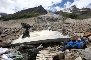 Volunteers collect wreckage of a United States army C-87 transport airplane crashed more than seven decades ago in the plateau region of Nyingchi <a href=