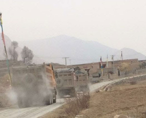 Mining trucks move along a road in Yadzi county, Qinghai, in an undated photo. Photo courtesy of an RFA listener