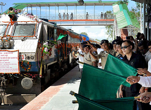 Union Minister of State for Sports and Youth Affairs, Sarbananda Sonowal along with RS Birdi GM NF Railway flagging off the Murkongselek- Guwahati Inter City Express and Murkongselek-Dekargaon Express at Murkongselek Railway Station (PTI Photo)