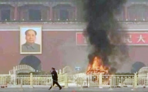 Flames shoot from a jeep after it crashed into the barrier of a bridge at Tiananmen Square in Beijing in 2013, killing three people inside the vehicle and two tourists. China billed it a terrorist attack by ethnic Uygurs. Photo: SCMP Pictures