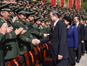 Yu Zhengsheng, chairman of the National Committee of the Chinese People's Political Consultative Conference (CPPCC), shakes hands with representatives from the People's Armed Police Force in Tibet, in Lhasa, capital of southwest China's Tibet Autonomous Region, Sept 7, 2015. (Xinhua/Li Tao)