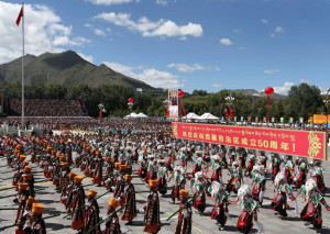 "Photo: Pang Xinglei, AP In this photo released by China's Xinhua News Agency, phalanxes attend a grand ceremony marking the 50th anniversary of the founding of the Tibet Autonomous Region at the square of the Potala Palace in Lhasa, capital of southwest China's Tibet Autonomous Region, Tuesday, Sept. 8, 2015. Schoolchildren waved flags and paramilitary troops marched in full battle dress as the Chinese government on Tuesday staged a mass spectacle marking 50 years since Tibet's establishment as an ethnic autonomous region firmly under the control of Beijing. The banner reads: ""Celebration for the 50th anniversary of the founding of the Tibet Autonomous Region."" (Pang Xinglei/Xinhua via AP)"