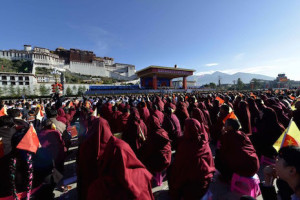 Thousands of people gather in front of Lhasa's Potala Palace on Sept. 8 for an event billed as marking 50 years since the founding of the administrative area of Tibet. (Photo by AFP)