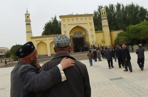 Muslim Uighur men walk toward a mosque in Kashgar, in China's western Xinjiang region. China's strategy for dealing with Tibetans is reflected in its treatment of other religious groups, including Muslims and Christians. (Photo by Greg Baker/AFP)