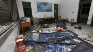 A damaged room in a residential building is seen after several locations were targeted with parcel bombs <a href=