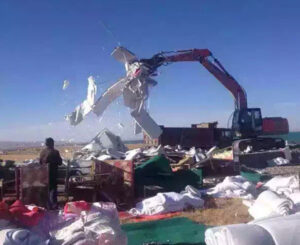 Chinese work crew tears down 'illegal' Tibetan structures near Qinghai Lake in an undated photo. Photo courtesy of an RFA listener
