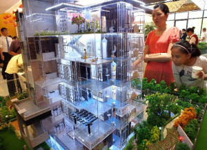 Chinese homebuyers visit a showroom in Yichang, Hubei province. (STR/AFP/Getty Images)