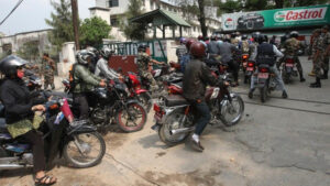 Nepalese motorcyclists queue at a petrol pump during a fuel shortage in the capital Kathmandu <a href=