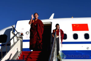 The 11th Panchen Lama (L), Bainqen Erdini Qoigyijabu, waves to bid farewell in Xigaze, southwest ...